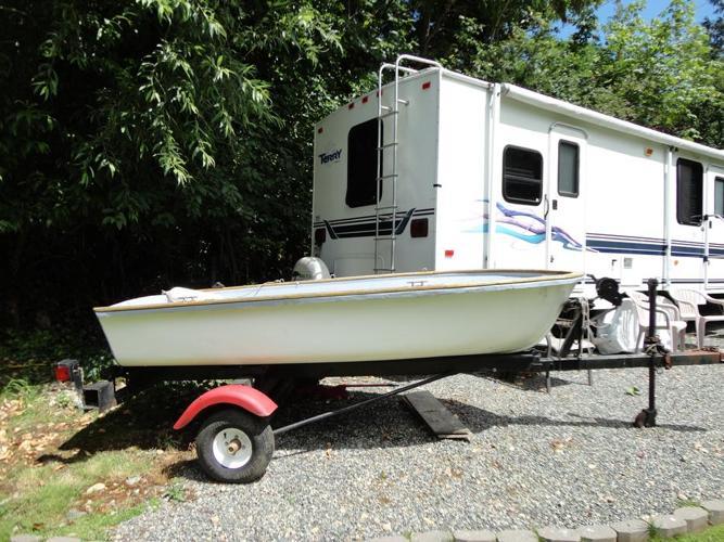 10 1/2 foot fiberglass boat with trailer