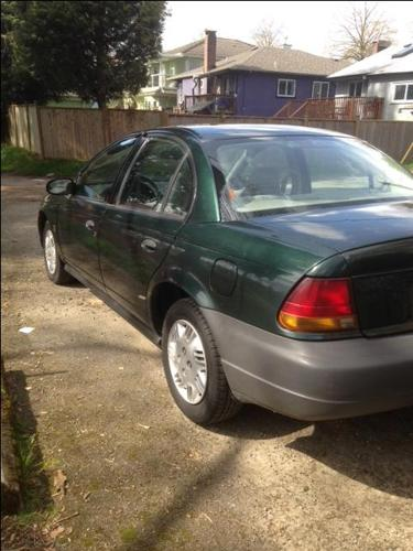 1996 Saturn SL1 4 door 163,600 kms, auto,AC  works well,$1250,