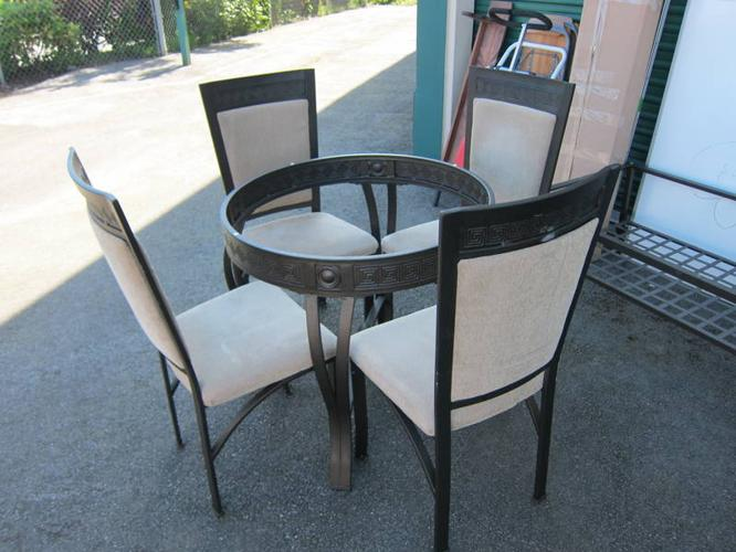 apartment size glass dining room table with 4 chairs for sale in