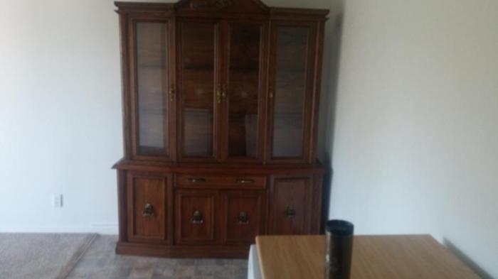 beautiful china cabinet glass shelves and light on top so you can see better
