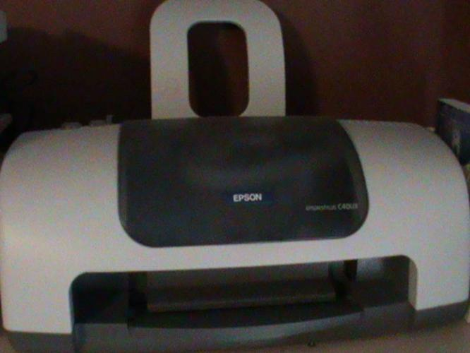 Epson stylus printer and panasonic fax machine(multipurpose)