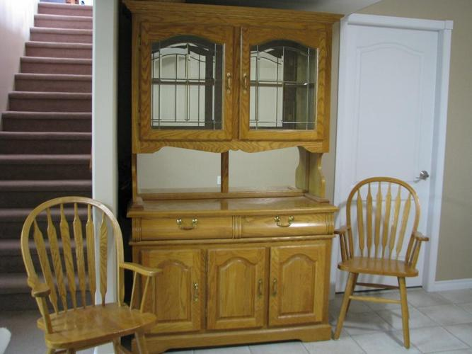 Oak buffet & matching hutch with 2 captain chairs