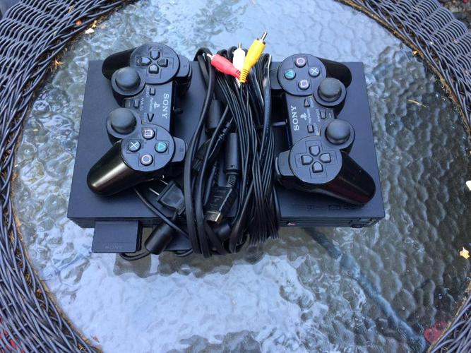 Playstation 2 with controllers and memory card