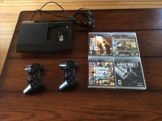 PlayStation 3 (500GB) with 4 games