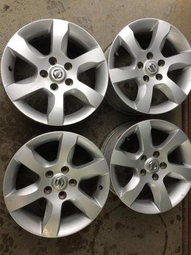 Set of 4 16X7 Nissan wheels 5on 115MM bolt pattern