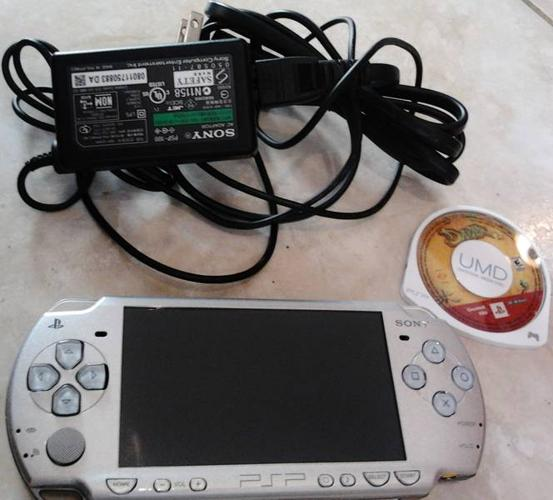 silver PSP with game