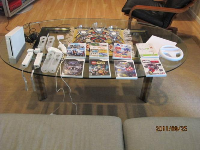 Wii + Wii fit and lots of other wii games and accessories