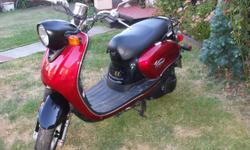 ONLY 4032 KILOMETERS TWICE THE FUN OF A 50cc SURE MAKES A DIFFERENCE TO HAVE MORE POWER 120 K FOR 5 BUCKS RUNS LIKE NEW STILL THIS IS A GOOD QUALITY SCOOTER VINO 125 BY YAMAHA