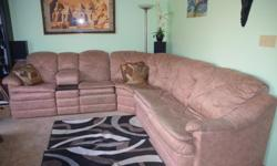 Used, but in good condition Sectional Reclining Sofa with built-in sofa bed. 2 manual reclining positions.