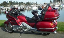 2004 Goldwing 1800cc Candy apple red, Goldwing for sale. Very low mileage, 18,600 miles . Built in USA, shipped it up from Atlanta Georga. The first owner worked to Honda and added all the stock accessories. Strong bike, 1800 cc, very comfortable for