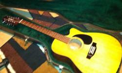 I am sellin my takamine g series guitar, it's in good condition, I just don't play it enough. Comes with an awesome hard shell case! This ad was posted with the Kijiji Classifieds app.