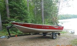 2006 14' WC with 2013 15hp four stroke Honda motor. Includes Karavan trailer and removable plywood floor. Some dock rash on one side but otherwise in excellent condition with absolutely no leaks. This is a very sold stable boat. Asking $4900 or best