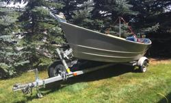 14 foot lifetimer drift boat Anchor setup front and rear. Built In anchor storage rack Two Sets of 8 foot oars. Wetlander bottom coat EZ loader trailer with LED lights and spare tire. Has a motor mount In Great Shape