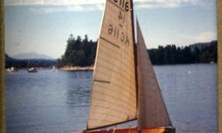 14 ft. International sail boat circa 1955. Fiberglass shell with cold molded mahogany interior and hollow sitka spruce mast. Original sails...Full main, 3/4 main, jib and spinnaker. Boat needs some tlc, but a great craft for the avid sailor. Trailer