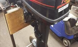 15hp Mercury Outboard -2 stoke -long shaft -comes with tank and hose -weights about 70lbs -light weight for the power