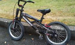 """Built like a Hummer! Has 16"""" wheels, fat knobbly tires, hand and coaster brakes and a quick release adjustment lever on the seat post. Good used condition."""