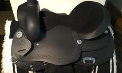 All black, leather with suede seat. Adjustable gullet system fits almost any horse. Saddle used 3 times as a demo. Has a few marks on it but is in very good condition. Duncan Retail new $900, now just $500! Price is firm.