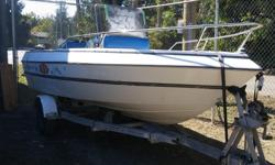 90 HP Evinrude, runs excellent, have disconnected plug in wires to pull motor off to put 175 HP on. Center consul, bilge pump cover. Comes with trailer, have trailer papers. $2200 firm.