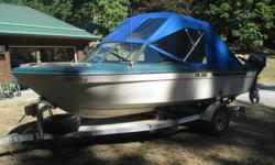 Full canvass, 115 H.P. Mariner, Trailer, VHF, GPS/Depthsounder Combo, Kicker bracket and assorted safety and fishing equipment. Built in tank. Plus 5 gal spare tank.