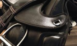 """Comes with leathers & irons too! Treeless, all black leather. 2 sets of shim underside pads to lift off the horse's back for comfort. 18"""" seat. Used approximately a year, always cleaned & stored in heated tack room. Was used on a 17.1h draft. Comes with"""
