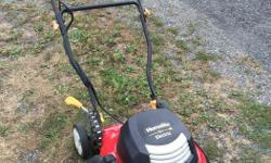 """This Homelite Electric Mower has a 18"""" cut width, 12 amp/120 volt motor, 2 in 1 tool - mulch and side discharge , single lever height adjust from 1-3/4 """" to 4 """" , cord management hook in handle, This mower is light weight ,has a 4.8 star rating, and does"""