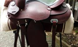 """Red brown gorgeous treeless barrel racing model. Great on long trail rides too! Black leather 18"""" seat is very well padded. Underside adjustable gullet using dense foam shin pads. This saddle is the ultimate in comfort for horse and rider! New. No more"""