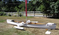 White Sea Clipper, kevlar, excellent condition. Kept indoors. Comes with sail, pontoons, two paddles and more. Great for family outings and big water canoe expeditions. Has motor mount for small motor Scooped yoke. Can be delivered.