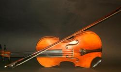 VINTAGE 1900 4/4 FRENCH/GERMAN MAPLE VIOLIN. My Grand Aunt, a nurse in France WW1 brought it back to Nova Scotia. I played it in an orchestra in my youth. My teacher, the concert master in the Windsor Symphony Orchestra 1960's said it has great