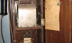 Have a beautiful old piece of Canadiana. It's a 1900s Canadian Independent Telephone Co. wall telephone (1919) Even has the original wiring diagram. Check this link to see what they sell for elsewhere.
