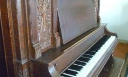 Made in Guelph, ON. Beautiful carving on front and legs. Lovely mellow tone.
