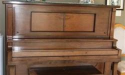 1913 Circa Strohber player piano.  Bellows need fixing.  You can play it like a regular piano just fine.  Appraised when bought at $3000.00.  Piano comes with approximately 100 rolls of music.  Some are very old but still in mint shape.  It worked when we