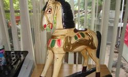 This beautiful handmade Rocking Horse was hand carved, painted and assembled by use of wooden plugs, not nails. She is truly a beautiful piece of art. Stands 2 feet high and is 8 inch across.