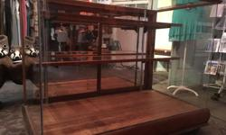 """1930's Oak display case. This beautiful antique gem is in great condition. 4' wide, 3' high, 2'3"""" deep. Sliding doors in the back with mirrors, 2 shelves that are adjustable. The case is on wheels too."""