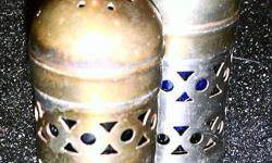 have a set of 1950 era silver salt and pepper shakers. These salt and pepper shakers are made of very high quality silver.