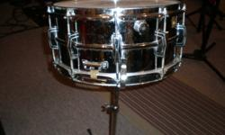 Supraphonic 400 snare drum  chrome    7x14       new strainer .                       Comes with original  ludwig  stand .  $400 obo              403 309-6997
