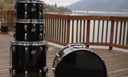 """Up for sale are my 1975 """"Smoke"""" Vistalite Ludwig Drums. I'm letting these drums go for a steal. The kick drum cracked in the early 80's and I replaced it with a black classic maple ludwig, it matches with the toms perfectly. All of the drums have new Remo"""