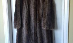 "Quality fur, raglan style sleeves, slight swing silhouette, full length 48"", approximate size 12. In excellent condition."