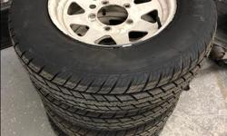 """1 front axle indoors since 1995. I cannot say condition other than functional and look very nice for age. The tires were new in 2012 and never put on road. They still have rubber wiskers on tread. They are Motomaster Total Terrain 205/75r15"""" on Samurai"""