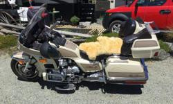 Goldwing in excellent condition original radio adjustable air ride ,cruise control, new tires ,and removable back rest for driver . Qualifies for collector plate status cheap insurance has only 32000 miles or 50000 km the bike originally came from Kansas.