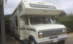 27 1/2 feet, 94000 km., 460 V8 7.5 L. Sleeps six. Separate bedroom, 4 burner stove with oven, microwave, 2 captain's chairs. Full bathroom. Kept in good condition.