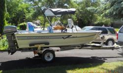 1993 Grumman 14' aluminum fishing boat. Full Carpeted floor with raised casting platform, lots of storage, livewell and 3 swivel seats. extras include remote controlled anchor, oar, fishfinder, canopy, and storage cover. Side consule steering wheel.