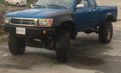 """Make Toyota Year 1993 Colour blue Trans Manual kms 293000 Strong running V6 standard transmission. Manual hubs. 4hi and 4low. Lifted 4"""", rancho shocks, All-pro Offroad extended shackles. Proper bracket lift, not just cranked torsion bars. BF Goodrich"""