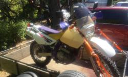 1997 Suzuki DR650 dual sport. Just had it tuned up. New battery, added a larger after market 6.6 L tank to it. Last owner had to change out the speedometer on it. So I'm not really sure the total KM's on it, but I only did 530km on it since I bought it