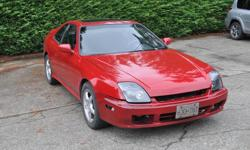 Make Honda Model Prelude Year 1998 Colour Red Trans Manual 1998 Prelude Type SH (sportier version) Runs great & well cared for classic Honda sports car. Has the H22A4 with VTEC. Factory alloys, power windows (new motors), locks & sunroof. Cold air intake,