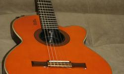 1999 Epiphone Chet Atkins Classical Electrical guitar. $450 obo.
