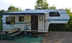 Canadian built, original owner, excellent condition, 25.5', hardwall, large fridge, oak package, lots of storage, ducted AC, DSI waterheater, power jacks, rear boat hitch, half ton towable. $10,500