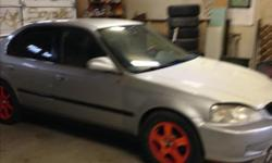 Make Honda Model Civic Colour grey Trans Automatic kms 220000 2000 Honda civic4 door automatic, nice clean interior starts good, runs good. has aftermarket rims and new winter tires. New sony CD deck with remote. New remote start, has power windows locks