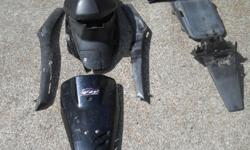 """Body parts from a 2000 Honda Dio """"City Movement"""" 50cc scooter. Usual wear for its age. Scratches etc. Small tear in the seat see photo. Headlight panel is broken by the right hand signal. Lights work. Plastic is faded. Scooter had 17K on it. Also oil"""