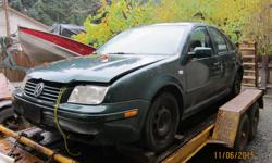 GREEN JETTA .. FRONT END DITCH DAMAGE .LOTS OF GOOD PARTS . GOOD TRANNY , NEW CLUTCH (I HAVE RECEIPT) ENGINE RUNS BUT BROKEN OIL PAN , NICE DOORS ,WINDOWS AND TRUNK . MANUAL WINDOWS . SEATS ARE MOULDY NOW . ALL THE BIG TICKET ITEMS ARE STILL HERE . COMES