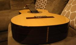 2001 Handmade Classical Guitar 650 scale. Solid european spruce top, mahogany neck with ebony fingerboard, solid rosewood sides and back. $499 obo. tel 250-618-5065.